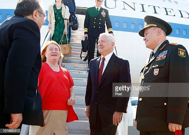 S Defense Secretary Robert Gates and his wife Becky Gates are greeted by Yashar Aliyev Azerbaijan's ambassador to the United States and Azerbajan's...