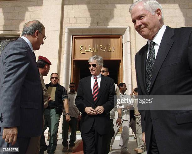 Defense Secretary Robert Gates and US Ambassador to Iraq Ryan Crocker exit the Iraqi Defence Ministry after meeting with Iraqi Minister of Defence...