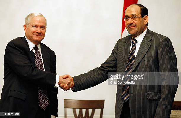 S Defense Secretary Robert Gates meets with Iraqi Prime Minister Nouri alMaliki at his compound April 7 2011 in Baghdad Iraq Gates is meeting with...