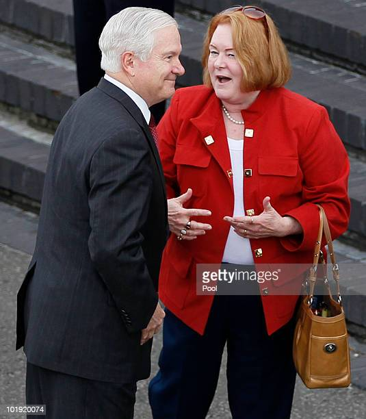 S Defense Secretary Robert M Gates and his wife Becky prepare to board a US Military Aircraft on June 9 at London's Heathrow Airport en route to...