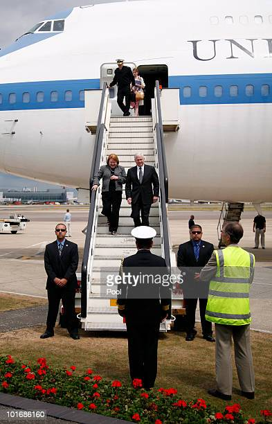 Defense Secretary Robert M Gates and his wife Becky walk down the boarding steps as they dsembark a plane to be greeted by Rear Admiral Ronald...
