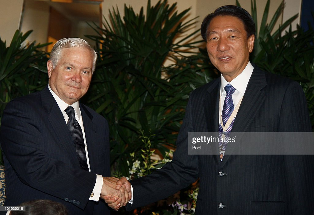 U.S. Defense Secretary Robert M. Gates and Singapore Minister of Defense Teo Chee Hean shake hands during their meeting at the Shangri-La Dialogue's Asia Security Summit on June 5, 2010 in Singapore. Gates is visiting five countries in his participation with the major Asian security conference in Singapore. In addition to Singapore, the secretary will travel to Azerbaijan, England, Belgium and Germany.