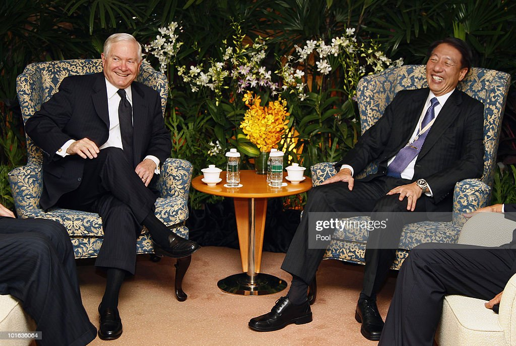 U.S. Defense Secretary Robert M. Gates and Singapore Minister of Defense Teo Chee Hean share a laugh before their meeting at the Shangri-La Dialogue's Asia Security Summit on June 5, 2010 in Singapore. Gates is visiting five countries in his participation with the major Asian security conference in Singapore. In addition to Singapore, the secretary will travel to Azerbaijan, England, Belgium and Germany.