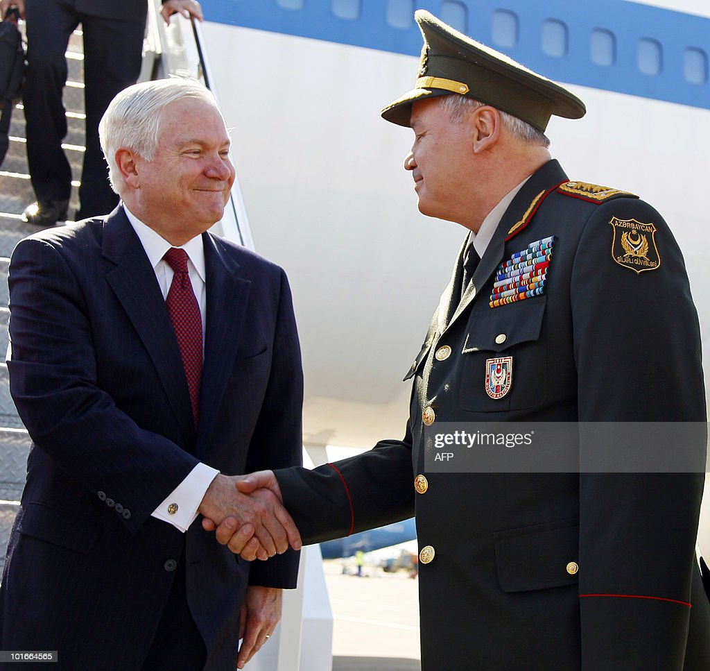 US Defense Secretary Robert M. Gates is greeted by Azerbajan's Minister of Defense, General-Colonel Safar Abiyev, as Gates arrives at the Heydar Aliyev International Airport in Baku, Azerbaijan June 6, 2010. Gates flew into Azerbaijan on Sunday to 'reassure' its leadership after Baku complained that Washington had neglected relations. AFP PHOTO/POOL/Carolyn Kaster