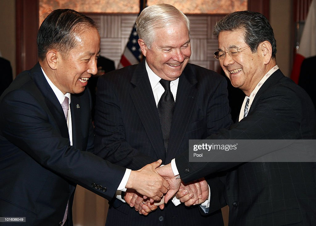 U.S. Defense Secretary Robert M. Gates (C) Japan's Minister of Defense Toshimi Kitazawa (R) and South Korean Defense Minister Kim Tae Young (L) shake hands during a meeting at the Shangri-La Dialogue's Asia Security Summit on June 5, 2010 in Singapore. Gates is visiting five countries in his participation with the major Asian security conference in Singapore. In addition to Singapore, the secretary will travel to Azerbaijan, England, Belgium and Germany.