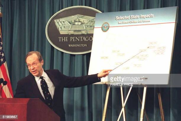 Defense Secretary William Perry briefs the press 28 February 1995 at the Pentagon using charts to indicate where the US military bases that have been...