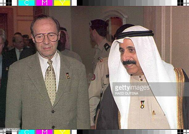 Defense Secretary William Perry is accompanied by Kuwaiti Defense Minister Sheikh Salem Al-Sabah in Kuwait city 29 November as he announced here that...