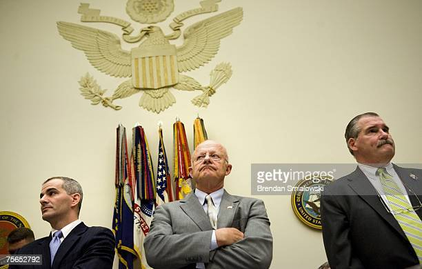 Defense Undersecretary for Intelligence James Clapper waits with Michael Leiter deputy director of the National Counterterrorsim Center and director...
