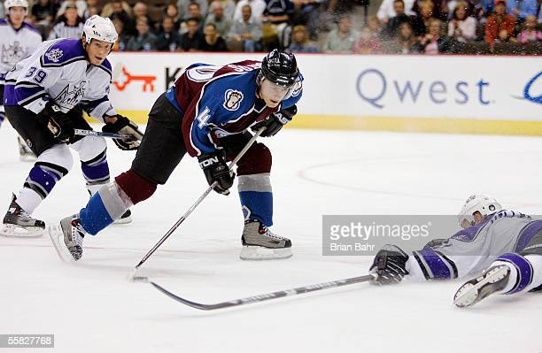 Defenseman Aaron Miller of the Los Angeles Kings lays out to block a shot by Marek Svatos of the Colorado Avalanche in the first period on September...
