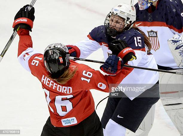 USA defenseman Anne Schleper cross checks Canada forward Jayna Hefford in the second period of the women's hockey gold medal game at the Bolshoy Ice...