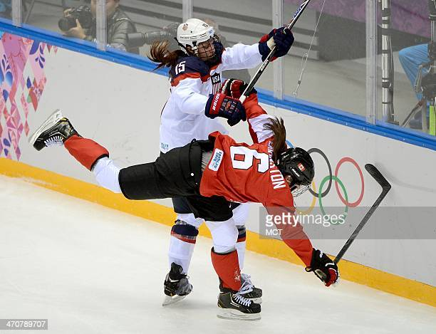 USA defenseman Anne Schleper hits Canada forward Rebecca Johnston during the second period of the women's hockey gold medal game at the Bolshoy Ice...