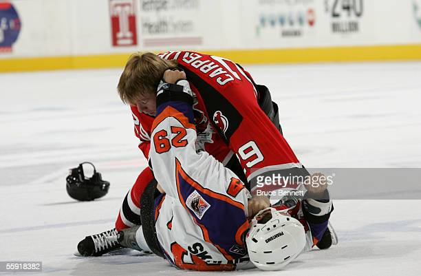 Defenseman Ben Carpentier of the Albany River Rats fights with defenseman Wade Skolney of the Philadelphia Phantoms during the game on October 9 2005...