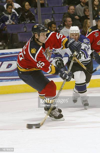 Defenseman Brad Ference of the Florida Panthers looks to pass as center Derek Armstrong of the Los Angeles Kings defends during the NHL game on...