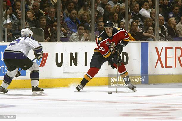 Defenseman Brad Ference of the Florida Panthers skates with the puck while being defended by left wing Mikko Eloranta of the Los Angeles Kings during...