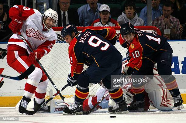 Defenseman Brad Stuart of the Detroit Red Wings battles center Stephen Weiss of the Florida Panthers on November 14 2008 at the BankAtlantic Center...