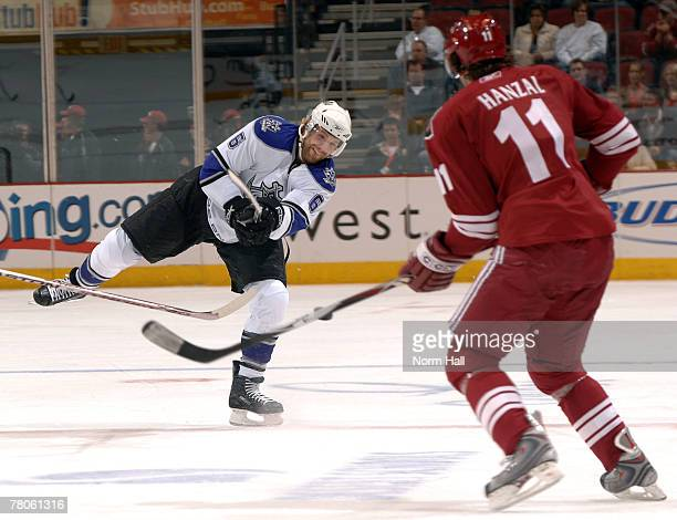 Defenseman Brad Stuart of the Los Angeles Kings tries to pass the puck past Center Martin Hanzal of the Phoenix Coyotes on November 21 2007 at...
