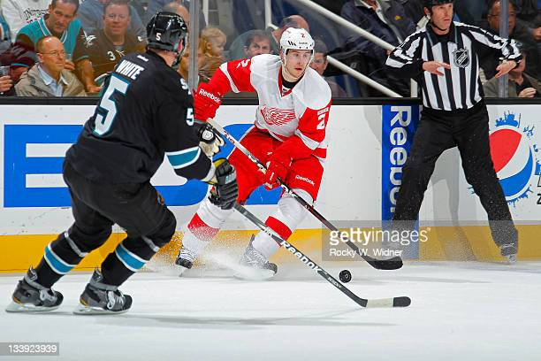 Defenseman Brendan Smith of the Detroit Red Wings controls the puck against defenseman Colin White of the San Jose Sharks at the HP Pavilion on...