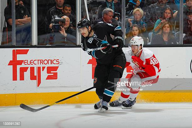 Defenseman Brent Burns of the San Jose Sharks fires a shot against center Cory Emmerton of the Detroit Red Wings at the HP Pavilion on November 17...