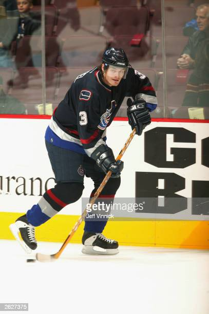 Defenseman Brent Sopel of the Vancouver Canucks skates with the puck against the Edmonton Oilers during the NHL game on October 11, 2003 at General...