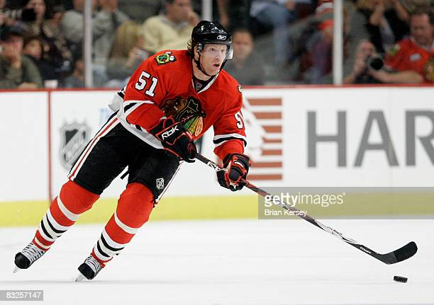 Defenseman Brian Campbell of the Chicago Blackhawks skates with the puck against the Nashville Predators during the third period at the United Center...