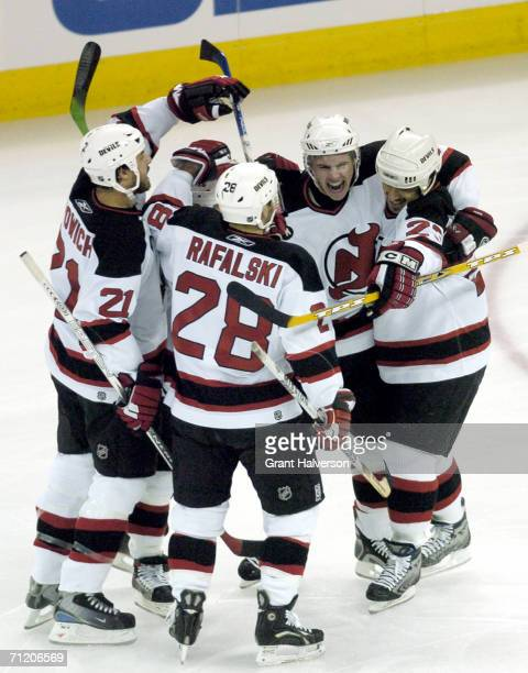 Defenseman Brian Rafalski of the New Jersey Devils celebrates with his teammates in game five of the Eastern Conference semifinals against the...