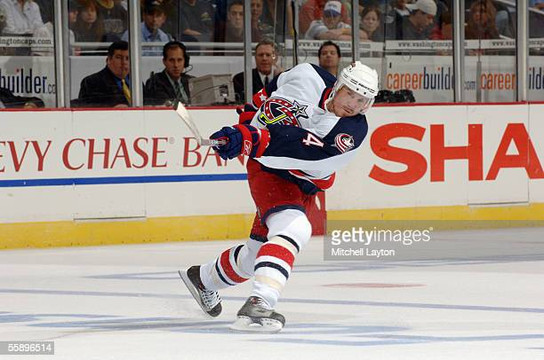 Defenseman Bryan Berard of the Columbus Blue Jackets shoots the puck against the Washington Capitals during the NHL game on October 5 2005 at MCI...
