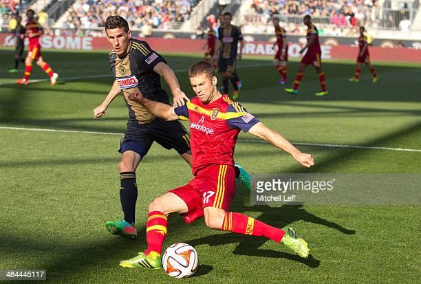 Defenseman Chris Wingert of Real Salt Lake kicks the ball with forward Sebastien Le Toux of the Philadelphia Union defending on the play on April 12...