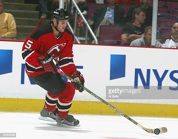 Defenseman Colin White of the New Jersey Devils controls the puck against the New York Islanders on September 24 2003 at the Continental Airlines...