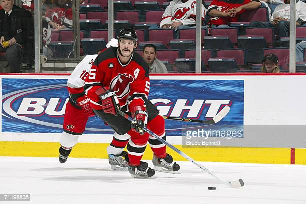 Defenseman Colin White of the New Jersey Devils controls the puck against the Carolina Hurricanes in game four of the Eastern Conference Semifinals...
