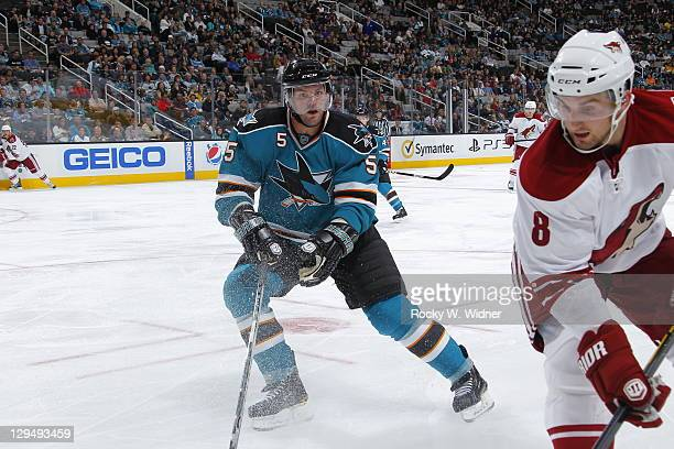 Defenseman Colin White of the San Jose Sharks defends against right wing Brett Maclean of the Phoenix Coyotes at the HP Pavilion on September 24 2011...
