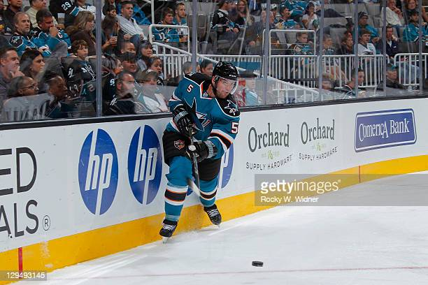 Defenseman Colin White of the San Jose Sharks makes a pass from behind the net against the Phoenix Coyotes at the HP Pavilion on September 24 2011 in...