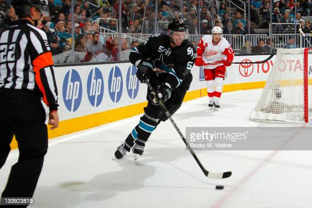 Defenseman Colin White of the San Jose Sharks skates with the puck against the Detroit Red Wings at the HP Pavilion on November 17 2011 in San Jose...