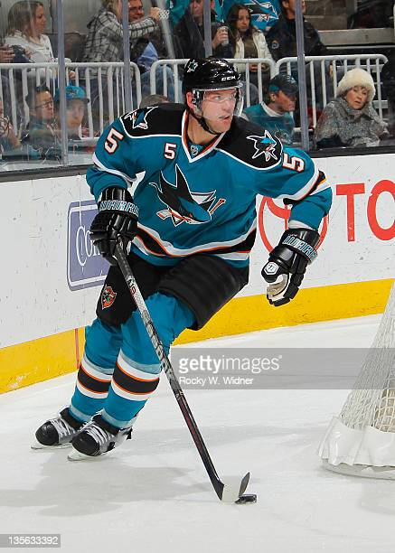 Defenseman Colin White of the San Jose Sharks skates with the puck against the Florida Panthers at the HP Pavilion on December 3 2011 in San Jose...