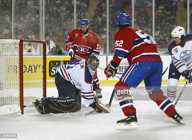 Defenseman Craig Rivet of the Montreal Canadiens watches the puck get by goalie Ty Conklin of the the Edmonton Oilers during the Molson Canadien...