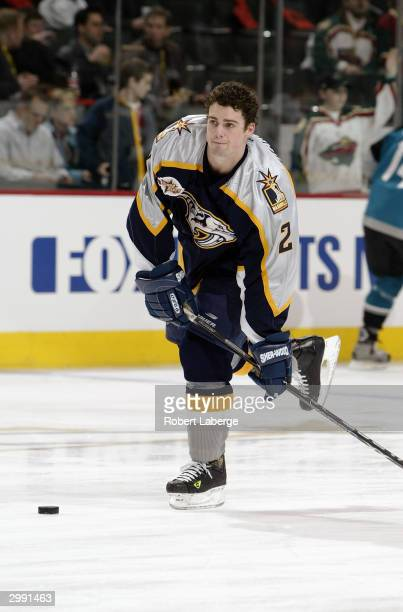 Defenseman Dan Hamhuis of the Nashville Predators of the West YoungStars sets up for a wrist shot during warm up prior to taking on the East...