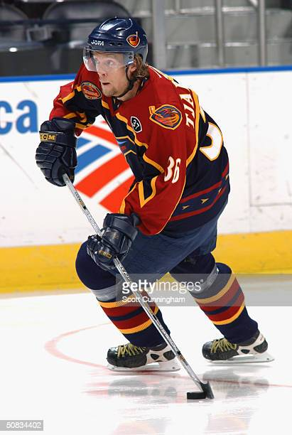 Defenseman Daniel Tjarnqvist of the Atlanta Thrashers advances the puck against the Carolina Hurricanes during the game at the Philips Arena on March...