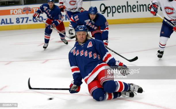 Defenseman Darius Kasparaitis of the New York Rangers drops to block a shot against the Montreal Canadiens during the Rangers home opener at Madison...