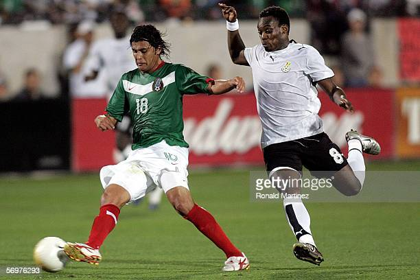 Defenseman Diego Martinez of Mexico moves the ball past Michael Essien of Ghana on March 1 2006 at Pizza Hut Park in Frisco Texas Mexico defeated...