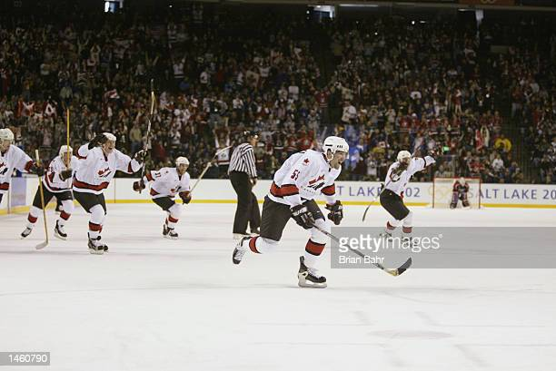 Defenseman Ed Jovanovski of Canada and the rest of the Canada bench skate to celebrate with the rest of the team after time expires in the third...