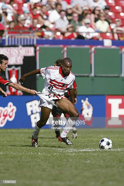 Defenseman Eddie Pope of the DC United has his shorts pulled by Rodrigo Faria left of the New York/New Jersey MetroStars on August 25 2002 at Giants...