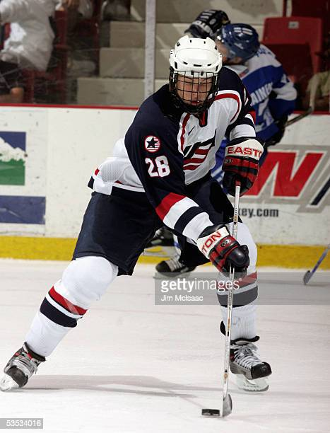 Defenseman Erik Johnson of the United States controls the puck against Finland during USA Hockey's Junior Men's Summer Challenge on August 13, 2005...