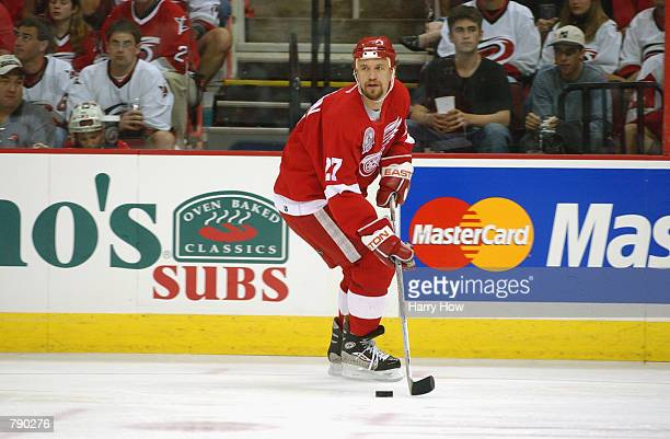 Defenseman Fredrik Olausson of the Detroit Red Wings looks to play the puck against the Carolina Hurricanes during game three of the NHL Stanley Cup...
