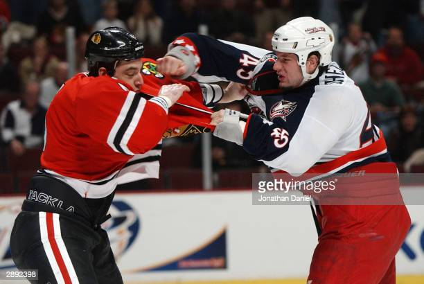 Defenseman Johnathan Aitken of the Chicago Blackhawks fights with left wing Jody Shelley of the Columbus Blue Jackets during a game on January 22...