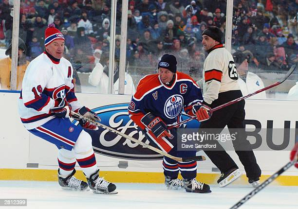 Defenseman Larry Robinson of the Montreal Canadiens defends against Wayne Gretzky of the Edmonton Oilers during the Molson Canadien Heritage Classic...
