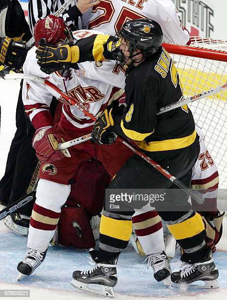 Defenseman Lee Sweatt of Colorado College shoves forward Adrian Veideman of the Denver Pioneers on April 7, 2005 during the NCAA Frozen Four at Value...