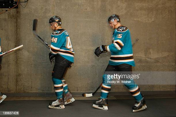 Defenseman MarcEdouard Vlasic and defenseman Colin White of the San Jose Sharks walk to the ice for the game against the Florida Panthers at the HP...