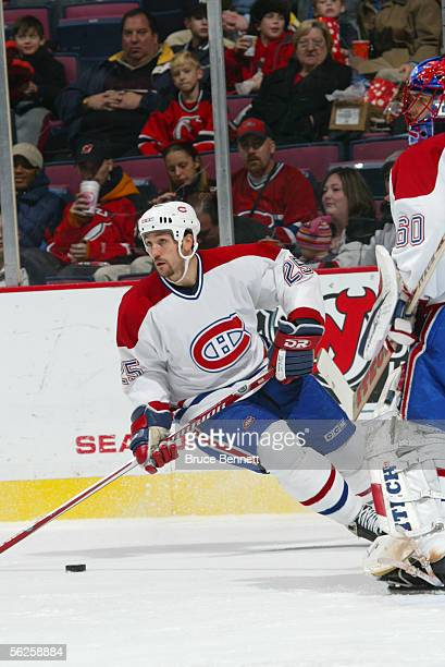 Defenseman Mathieu Dandenault of the Montreal Canadians skates on the ice during the game against the New Jersey Devils at the Continental Airlines...