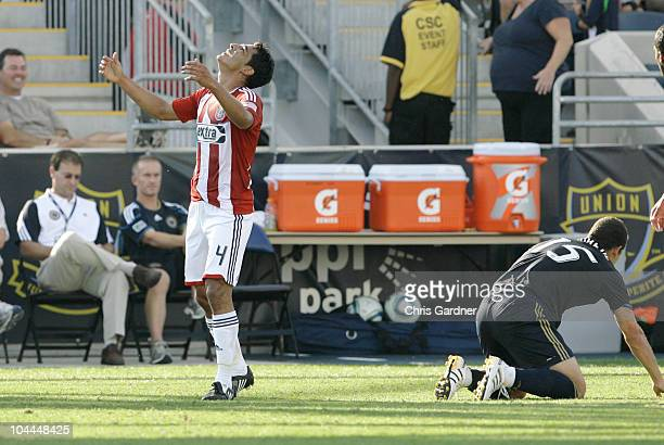 Defenseman Michael Umana of Chivas USA reacts after being charged for tipping Alejandro Moreno of the Philadelphia Union in the first half of their...