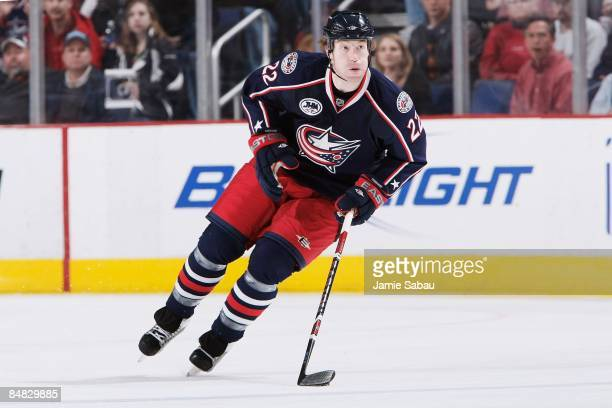 Defenseman Mike Commodore of the Columbus Blue Jackets skates with the puck against the Detroit Red Wings on February 13, 2009 at Nationwide Arena in...
