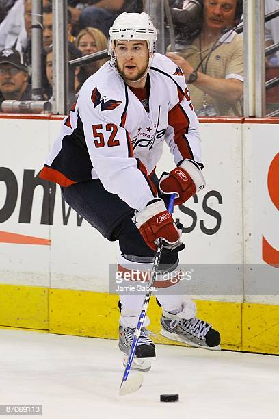 Defenseman Mike Green of the Washington Capitals skates with the puck against the Pittsburgh Penguins during Game Four of the Eastern Conference...